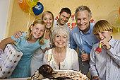 Senior woman celebrating birthday with family