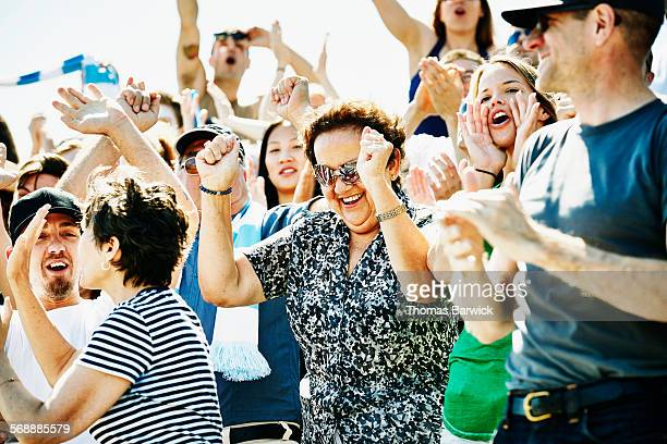 Senior woman celebrating during soccer match