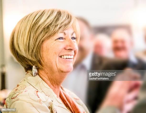 Senior woman celebrating retirement