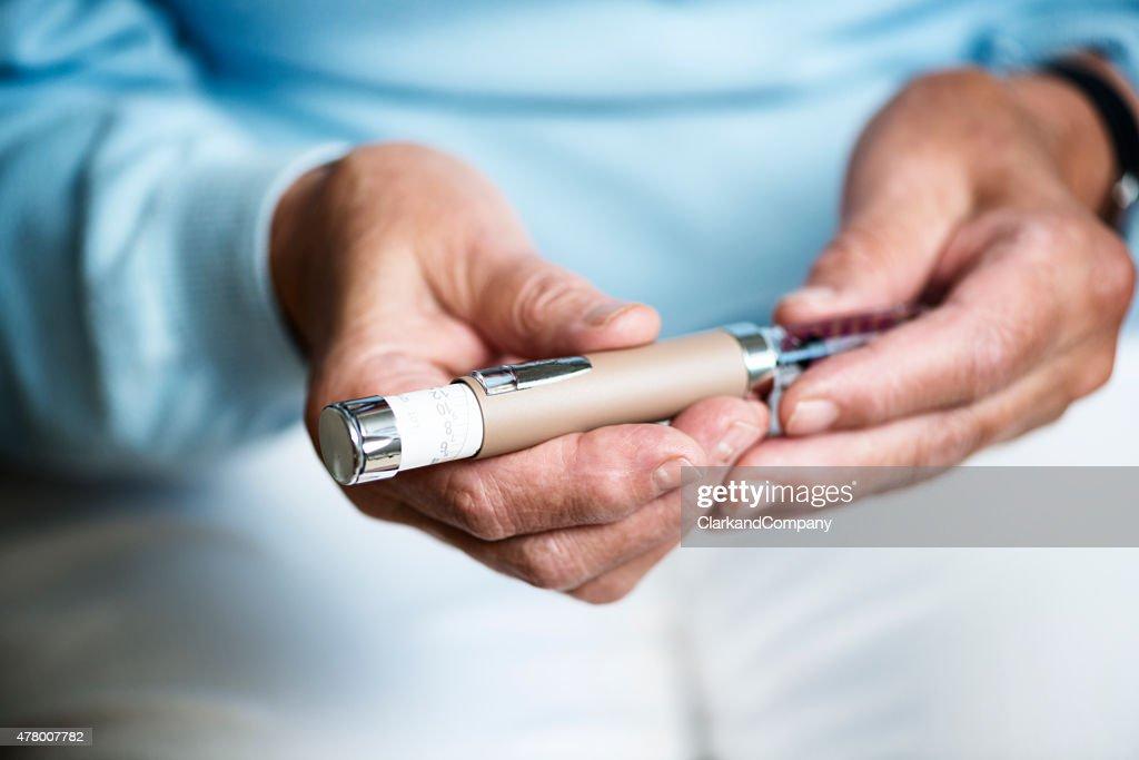 Senior Woman Checking Her Insulin Dosage.