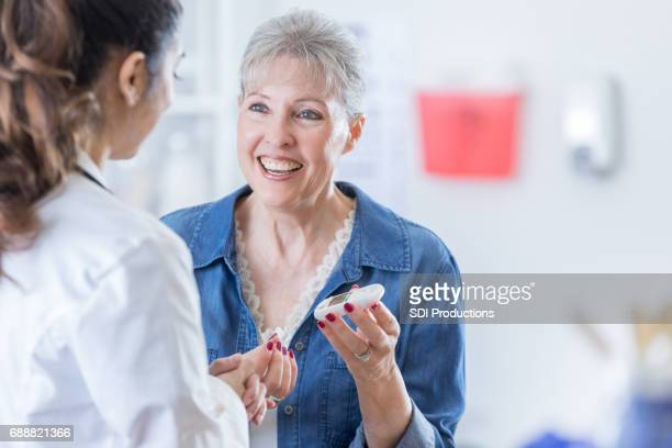 Senior woman checks blood sugar level