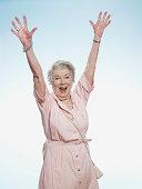 Senior woman cheering