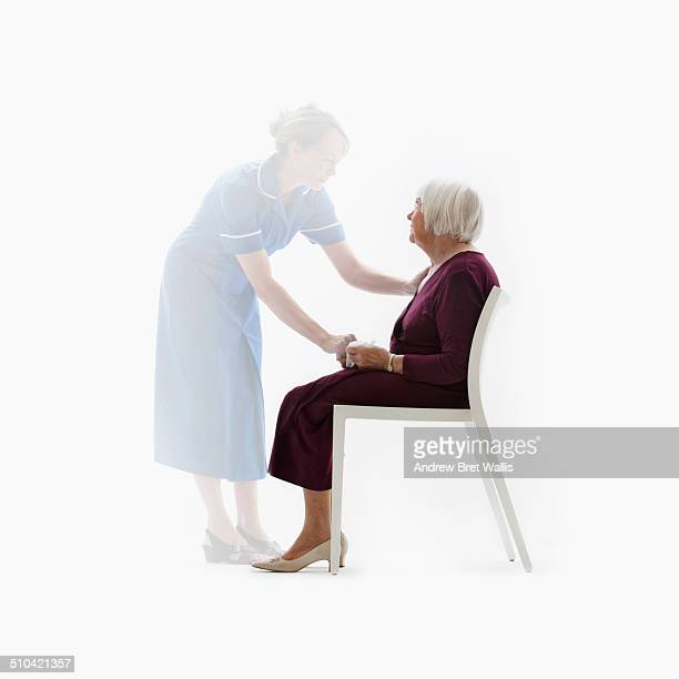 Senior woman comforted by ghosted carer