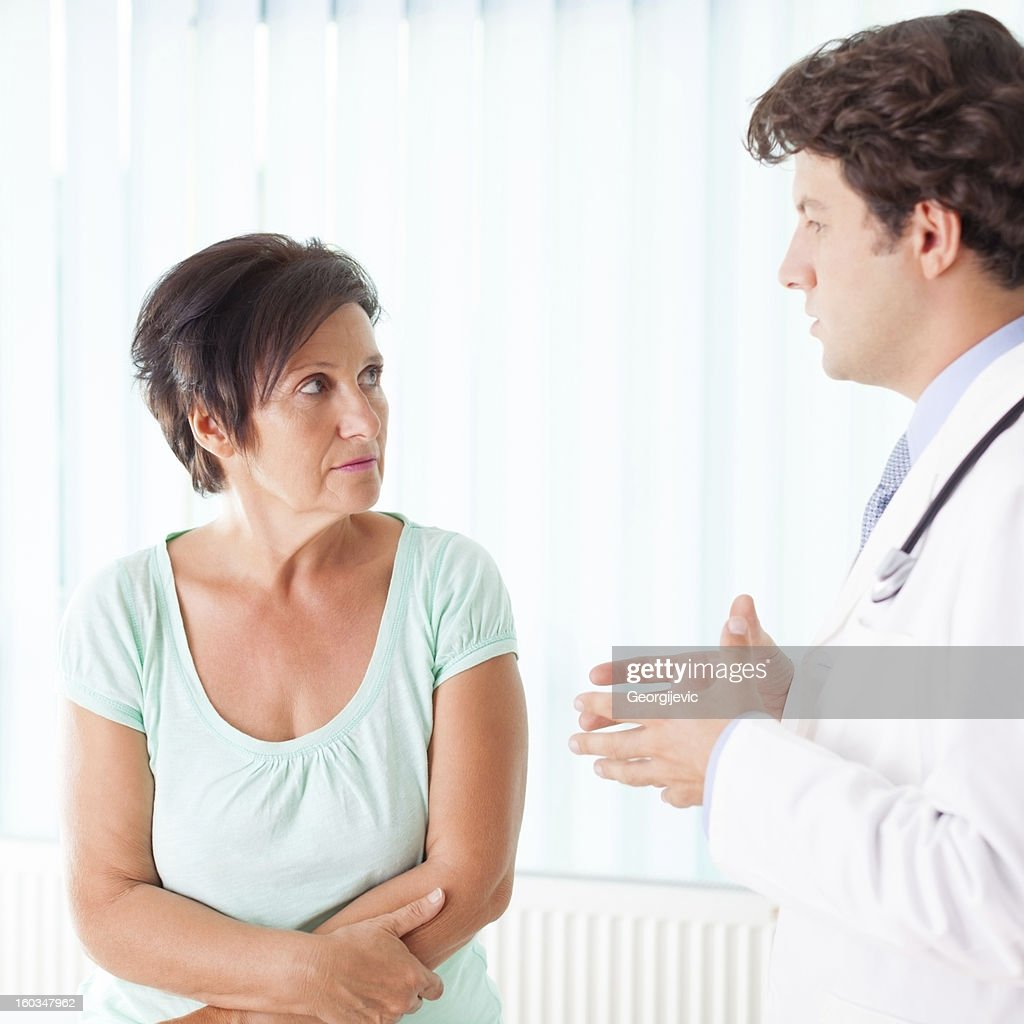 Senior woman communicate with doctor : Stock Photo