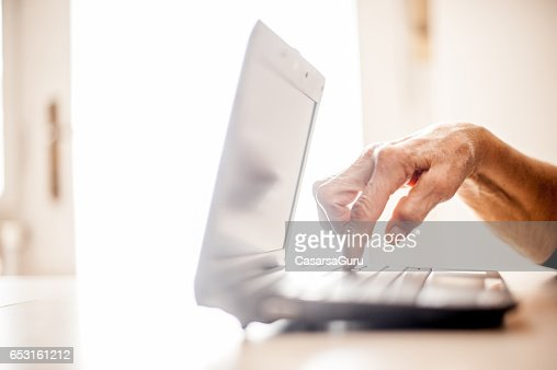 Senior Woman Determined To Use Computer - Close Up Hands : ストックフォト