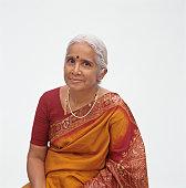 Senior woman dressed in sari posing in studio, portrait