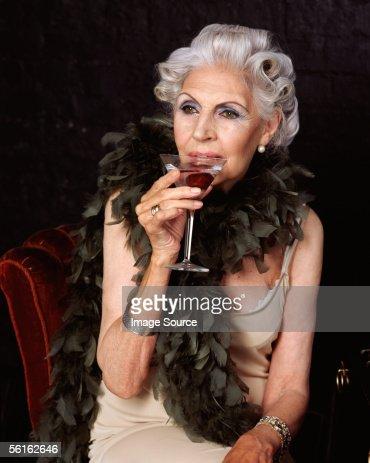 Senior woman drinking cocktail