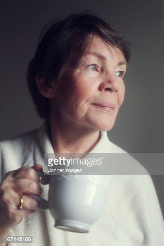 Senior woman drinking coffee : Stock Photo