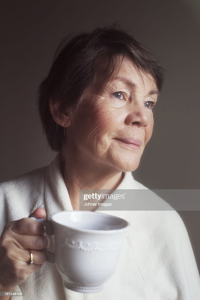 Senior woman drinking coffee : Stock Photo