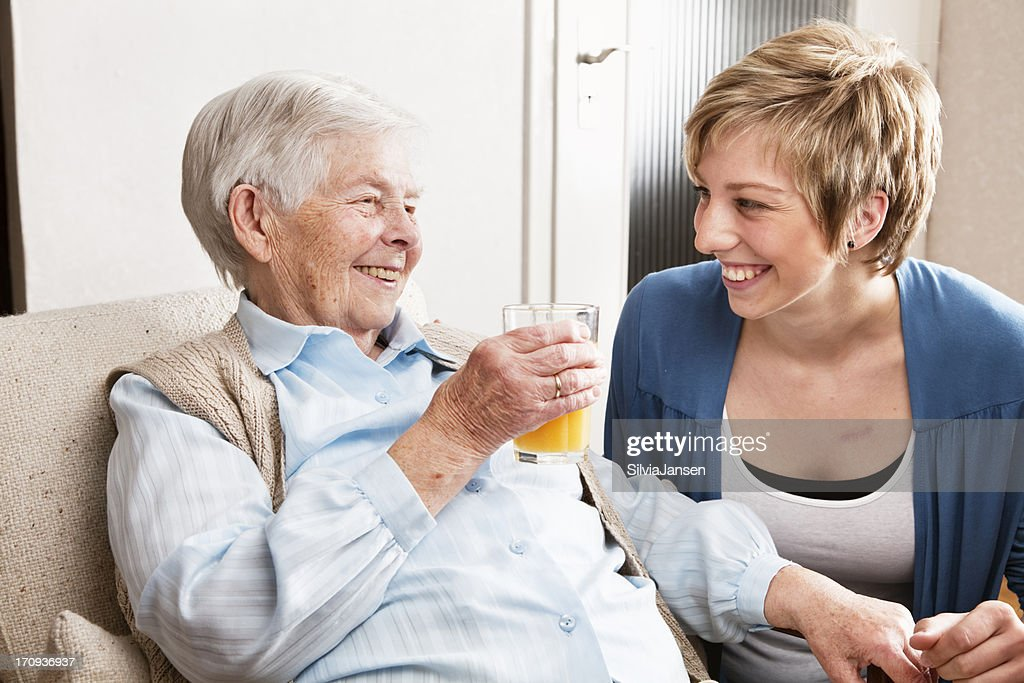 senior woman drinking orange juice