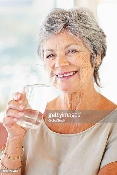 Senior woman drinking water