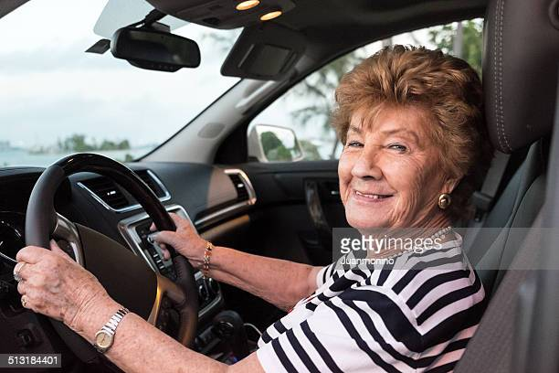 Senior woman driving her Vehicle