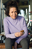 Senior Woman Eating Healthy Snack at Gym