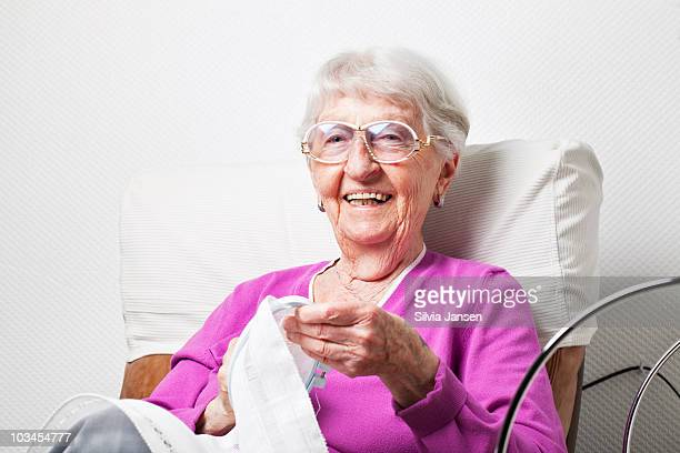 senior woman embroidering