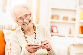 Senior woman enjoying a cup of coffee at home