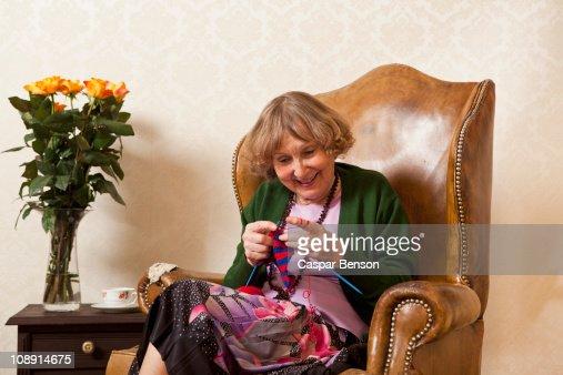 A senior woman enjoying knitting