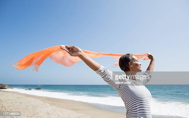 Senior woman enjoying the beach