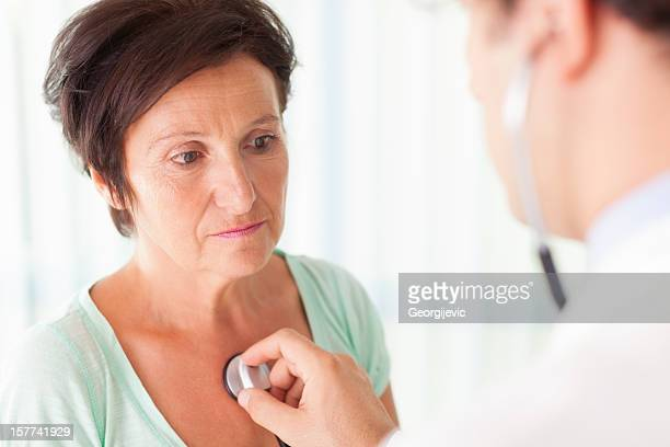 Senior woman examined by a doctor
