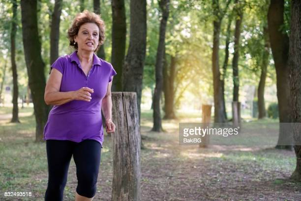 Senior woman exercising in the park
