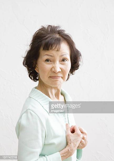 Senior woman frowning
