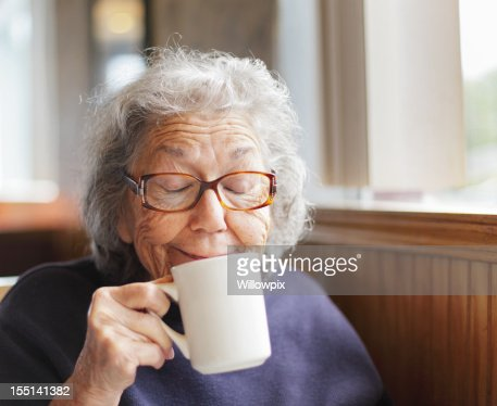Senior Woman Funny Face Smile With Coffee Cup