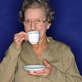 Senior woman having a cup of coffee