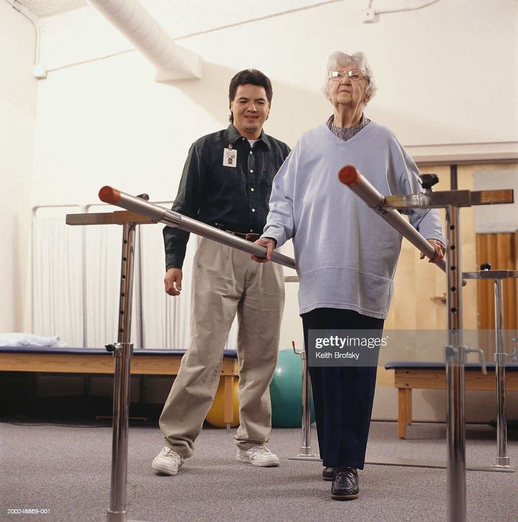 Senior woman having ambulatory therapy : Stock Photo