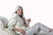 Senior Woman Having Glass of Champagne