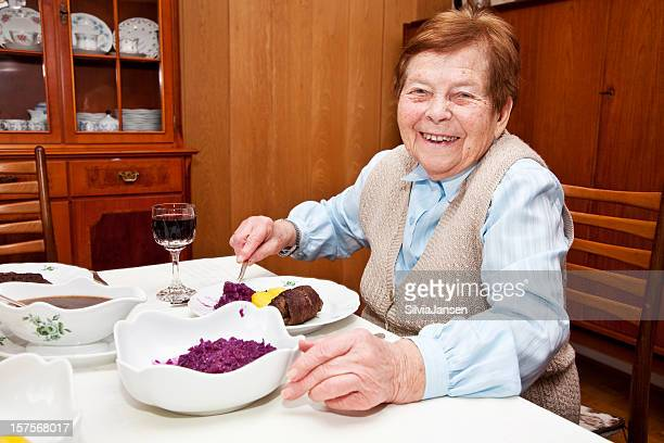 senior woman having lunch