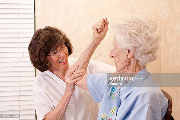 Senior woman having physical therapy on her arm.