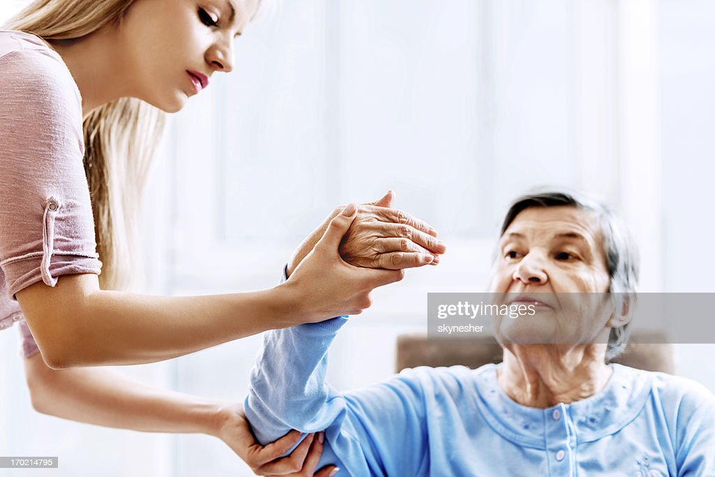 Senior woman having physical therapy.