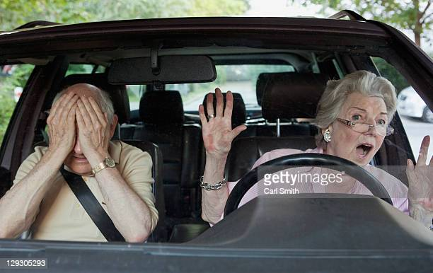 Senior woman having trouble learning to drive