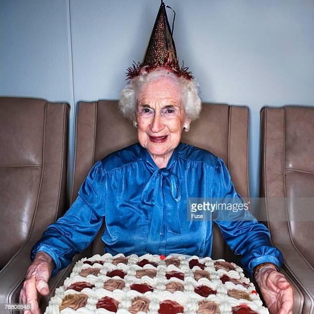 Senior Woman Holding a Birthday Cake