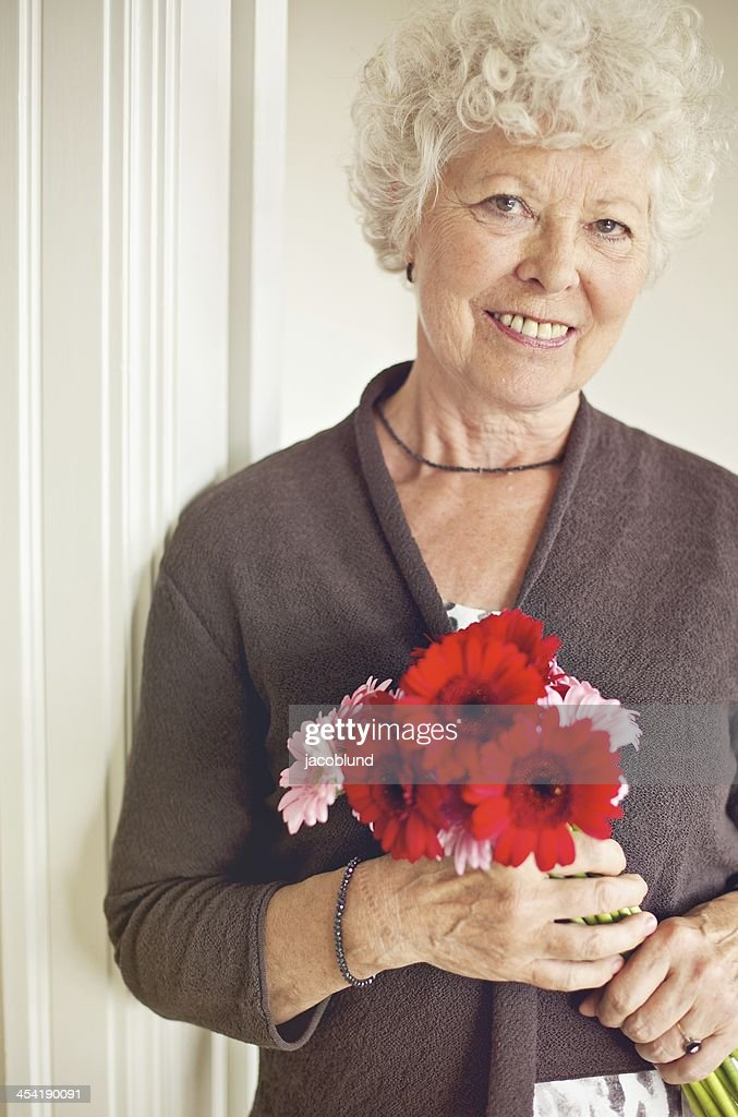 Senior Woman Holding a Bouquet of Fresh Flowers : Stock Photo