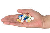 Senior woman holding assorted capsules in her hands. Conceptual of health care for the elderly.