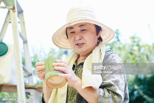 Senior woman holding bamboo bowl