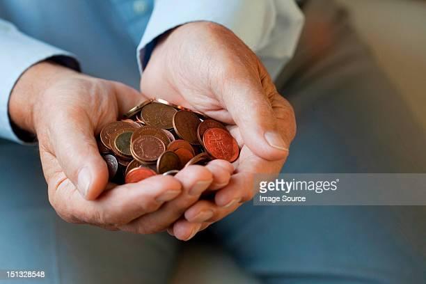 Senior woman holding coins
