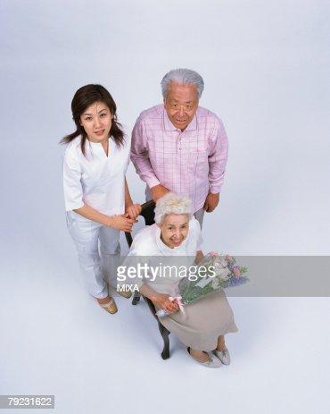 A senior woman holding flower : Stock Photo