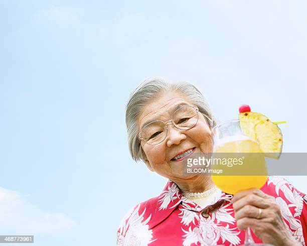 Senior Woman Holding Glass Of Juice