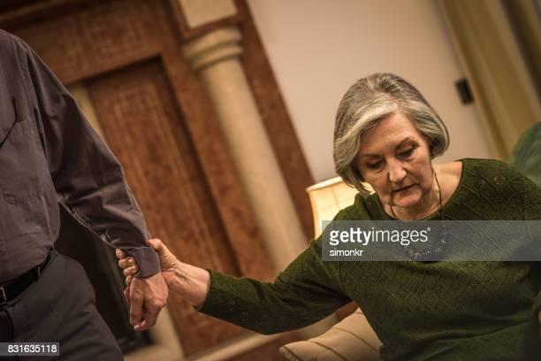 Senior woman holding hand