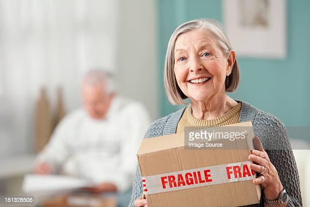 Senior woman holding parcel, portrait
