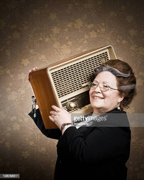 Senior Woman Holding Retro Radio