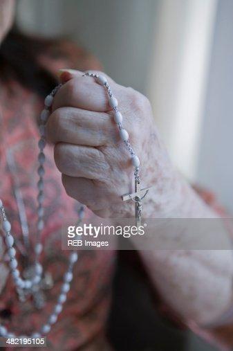 Senior woman holding rosary
