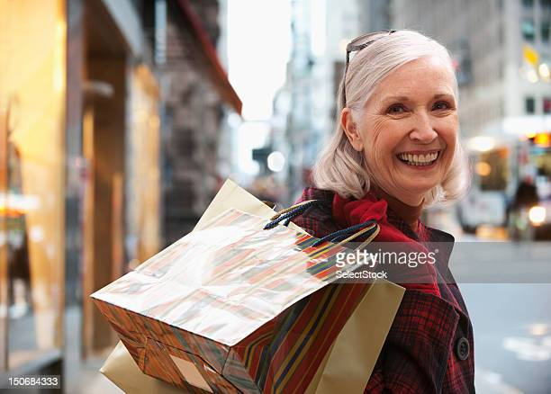 Senior woman holding shopping bags