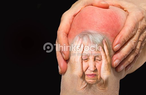 Senior woman holding the knee with pain : Foto stock