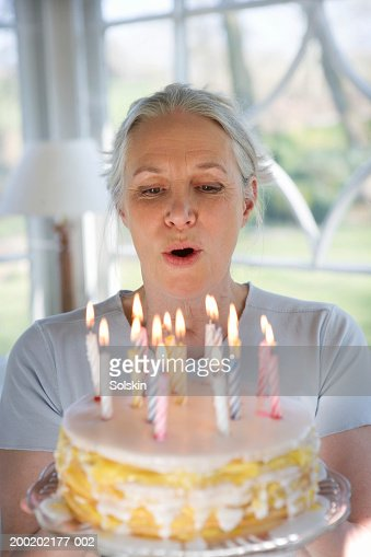 Old Woman Blowing Out Candles Stock Photos and Pictures  Getty Images