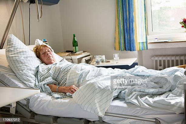 senior woman hospital lying in bed