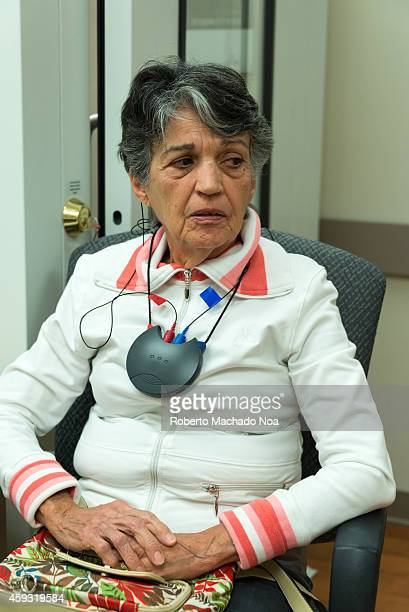 A senior woman in a hearing aid consultation audiometry and testing the new hearing aids