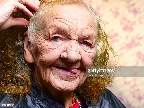 Senior woman in care home having hair done