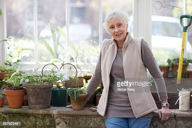 Senior woman in greenhouse